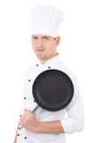 Portrait of young handsome man chef in uniform with teflon fryin Royalty Free Stock Image