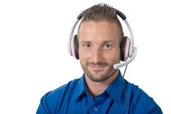 Portrait of young handsome man with headset on white royalty free stock photography