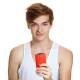 Portrait of young handsome man holding deodorant Stock Images