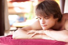 Portrait of young handsome man relaxing in spa Royalty Free Stock Photography