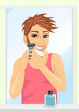 Portrait of young handsome man shaving Royalty Free Stock Image