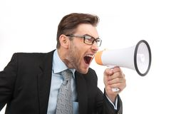 Portrait of young handsome man shouting using megaphone. Royalty Free Stock Photos
