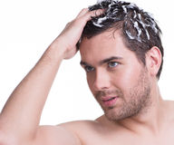 Portrait young handsome man washing hair. Stock Images