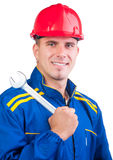 Portrait of young handsome mechanic with hard hat Royalty Free Stock Image