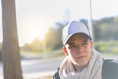 Portrait of a serious young man wearing a cap stock photos