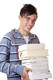 Portrait of young, handsome student holding books. Young student holding books and smiles happy into camera. Isolated on white Royalty Free Stock Photos