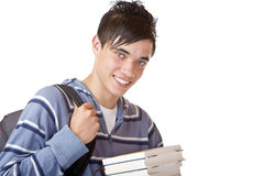 Portrait of young handsome student holding books. Young student holding books and smiles happy into camera. Isolated on white Royalty Free Stock Photos
