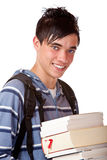Portrait of young handsome student holding books. Young student holding books and smiles happy into camera. Isolated on white Stock Photography