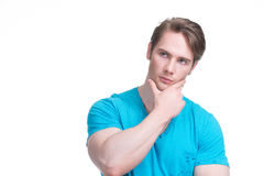 Portrait of young handsome thinking man. Stock Photo
