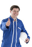 Portrait Of Young handyman Holding helmet Over White Stock Photo
