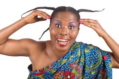 Young african woman with long braids. Portrait of young happy african woman with long braids on her head looking at camera and showing her hairstyle with both Stock Image