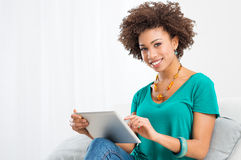 African Woman Using Digital Tablet stock photos
