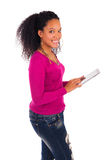 Portrait Of Young Happy African Woman Using Digital Tablet Stock Photo