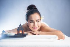Thai oil massage to beautiful Asian woman. Portrait of young happy Asian beautiful woman relax in spa. Body care treatment. Cute girl having Thai oil massage on royalty free stock photography