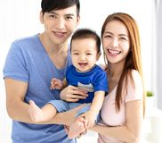 Young happy asian family with child Stock Images