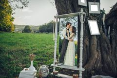 Portrait of young happy beautiful couple on nature royalty free illustration