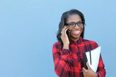 Portrait, young, happy beautiful woman in plaid shirt speaking on cell phone,  on blue background. Good news Stock Images