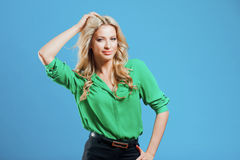 Portrait of young happy blonde, casual style, blue background Royalty Free Stock Image