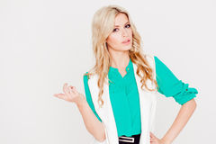Portrait young happy blonde, casual style, white background. Emotion of puzzling Stock Images