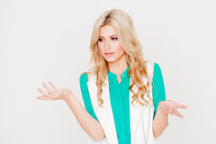 Portrait young happy blonde, casual style, white background. Emotion of puzzling Stock Photos