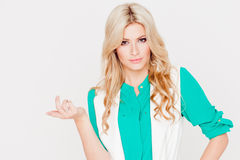 Portrait young happy blonde, casual style, white background. Emotion of puzzling Stock Image