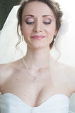 Portrait of young  happy bride looking down Royalty Free Stock Photos