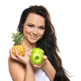 Portrait of a young and happy brunette with fruits Stock Image