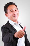 Portrait of young happy business man showing thumb up Stock Image