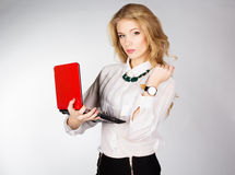 Portrait of a young happy business woman with a laptop. Over white background Royalty Free Stock Image