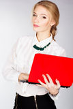 Portrait of a young happy business woman with a laptop. Over white background Stock Image