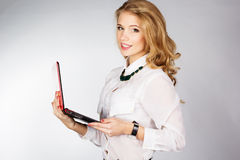 Portrait of a young happy business woman with a laptop. Over white background Royalty Free Stock Photo