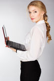 Portrait of a young happy business woman with a laptop. Over white background Stock Images