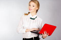 Portrait of a young happy business woman with a laptop. Over white background Royalty Free Stock Photography