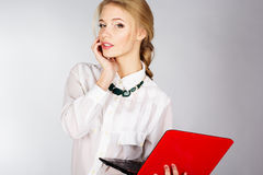 Portrait of a young happy business woman with a laptop. Over white background Stock Photography