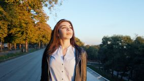 Portrait of young happy business woman walking alone the city. Beautiful caucasian student girl in white blouse stock footage