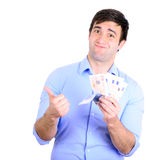 Portrait of young happy businessman holding money in his hands Stock Image