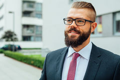 Portrait of a young happy businessman outside the office buildin Royalty Free Stock Image