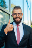 Portrait of a young happy businessman. Thumb up. Positive emotio Stock Photo