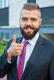 Portrait of a young happy businessman. Thumb up. Positive emotio Royalty Free Stock Photos