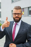 Portrait of a young happy businessman. Thumb up. Positive emotio Royalty Free Stock Images