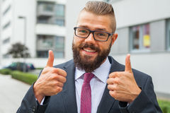 Portrait of a young happy businessman. Thumb up. Positive emotio Royalty Free Stock Photo
