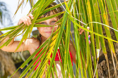 Portrait of young happy child girl in tropical backgroun Royalty Free Stock Images