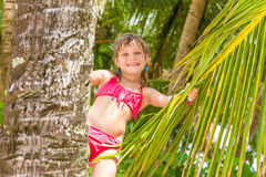 Portrait of young happy child girl in tropical backgroun Stock Photography
