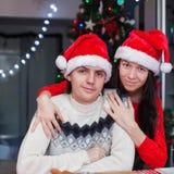 Portrait of young happy couple baking Christmas Stock Image