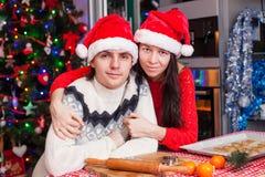 Portrait of young happy couple baking Christmas Stock Photo