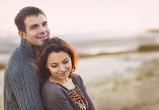 Portrait of young happy couple laughing in a cold day by the aut Royalty Free Stock Photos