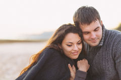 Portrait of young happy couple laughing in a cold day by the aut Stock Photos
