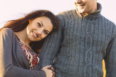 Portrait of young happy couple laughing in a cold day by the aut. Closeup portrait of young happy couple laughing in a cold day by the autumn sea Royalty Free Stock Photography