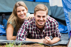 Portrait of a young happy couple lying in a tent Stock Photo