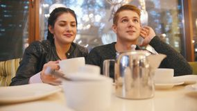 Portrait of young happy couple - male nad female in cafe stock video footage